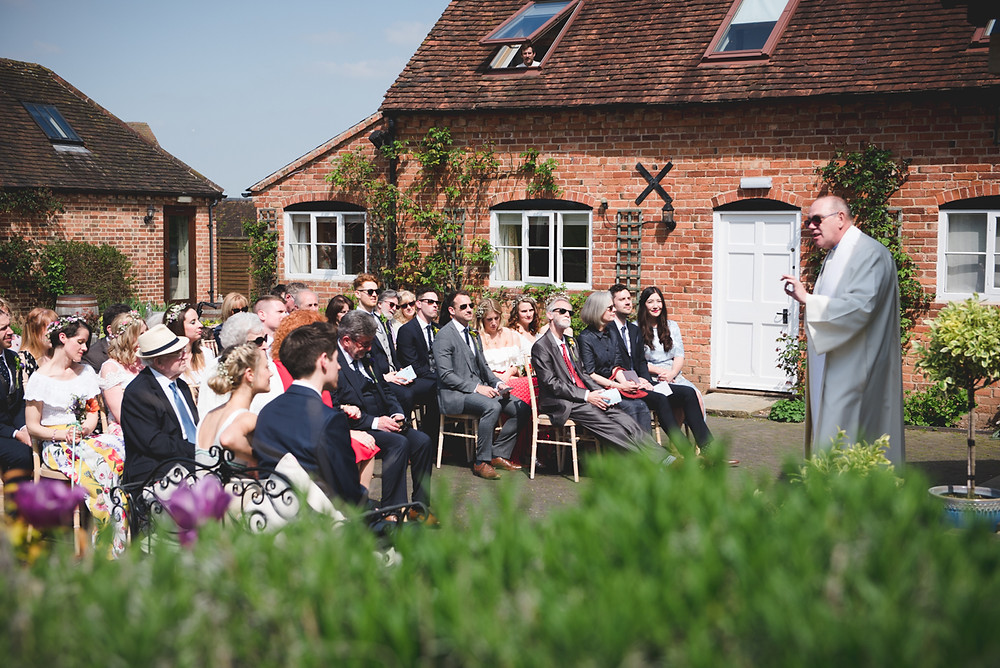 Outdoor wedding blessing at Wethele Manor in Warwickshire