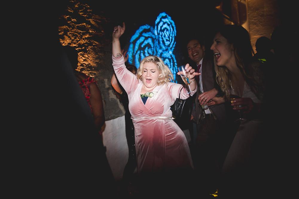 bridesmaid dancing at bristol paintworks wedding