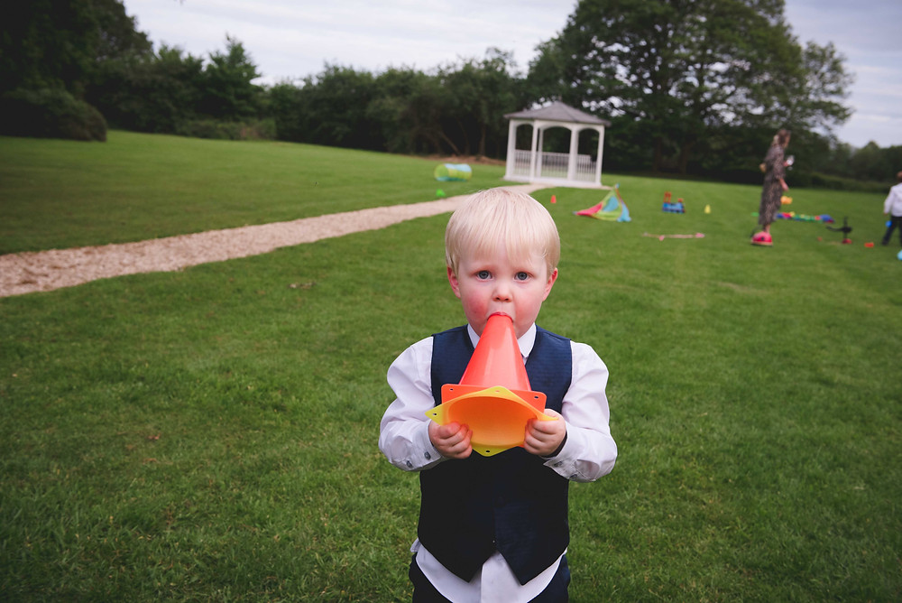 young guest having fun at Somerford hall wedding