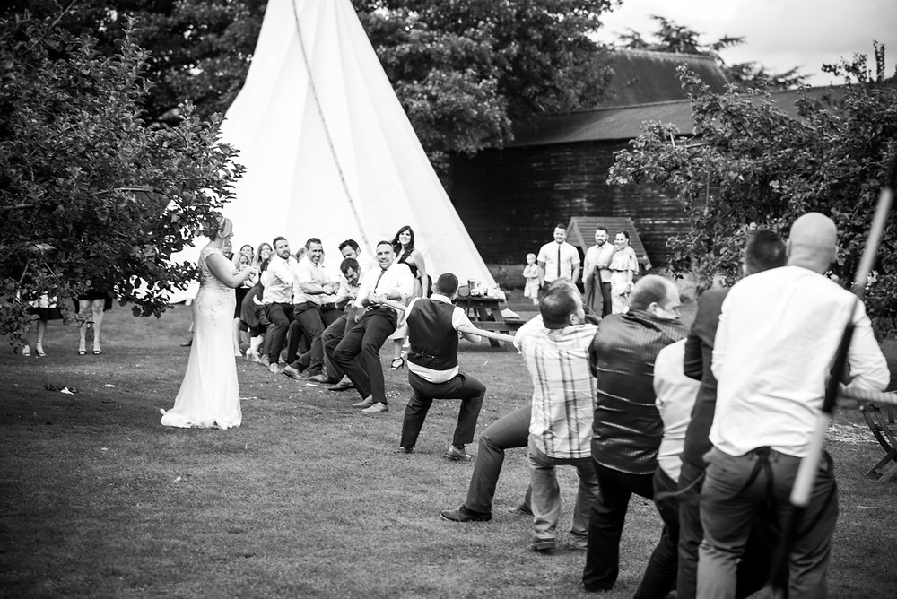 Black & white reportage image of tug of war contest at The Fleece Inn, Bretforton