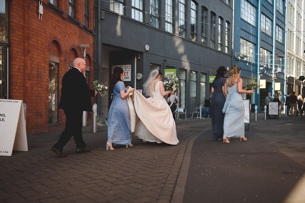 Bridal party waling across Gibb Street in Digbeth to The old Library