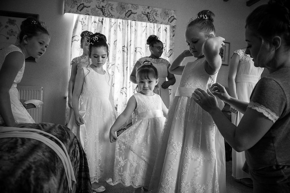Flower girls getting ready at Delbury Hall in Shropshire
