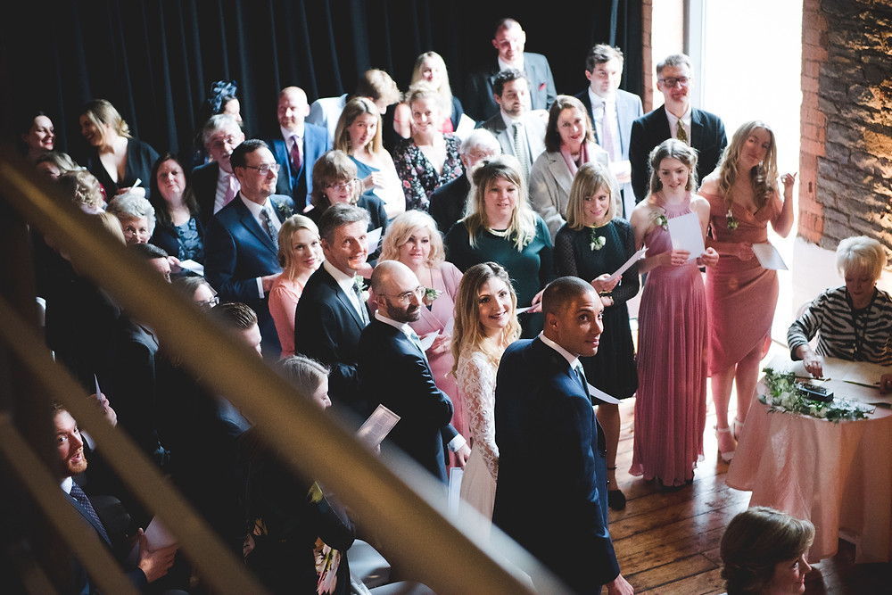 guests looking up at trumpet player during bristol wedding ceremony