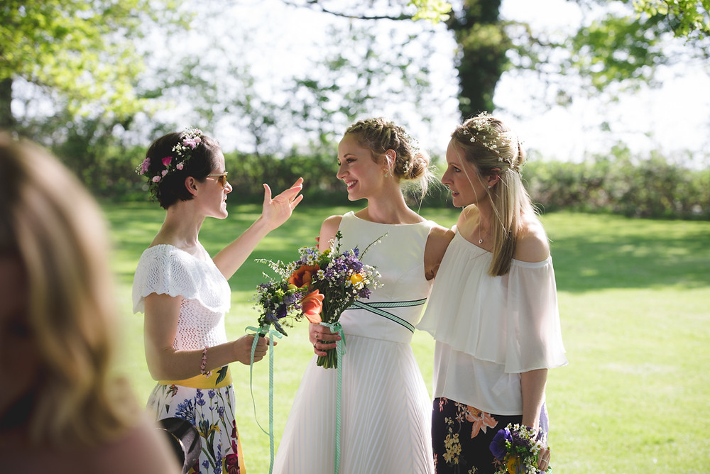 Bride & Bridesmaids in the sun at outdoor wedding ceremony near Leamington Spa