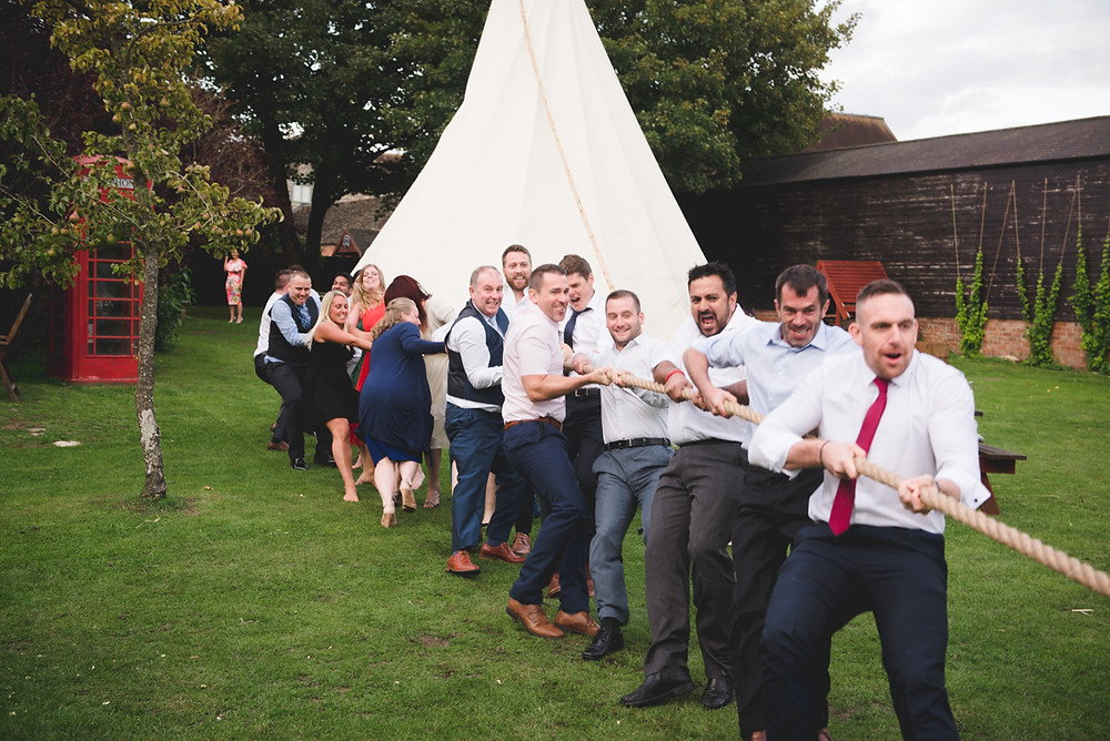 Tug of war at wedding in The Cotswolds