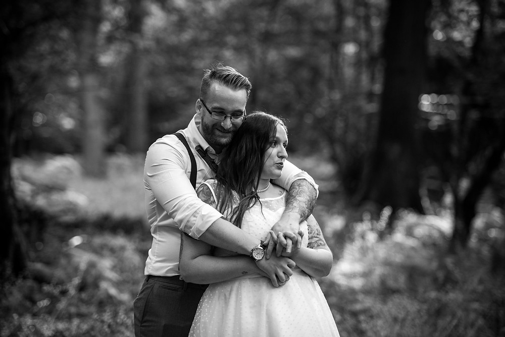 bride and groom enjoying time together in woods