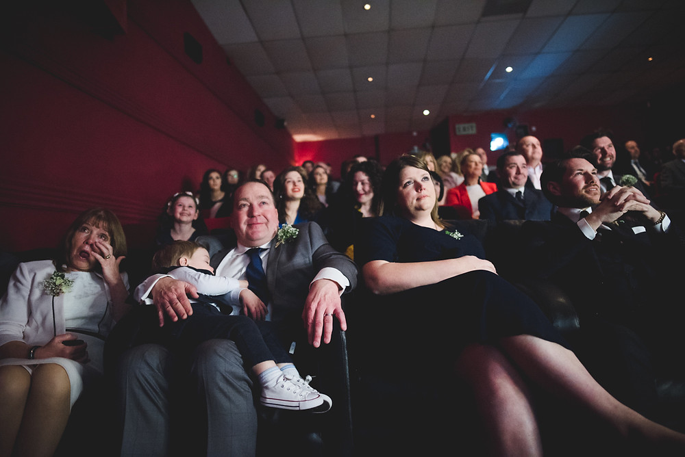 emotional wedding guests in cinema seats at The Electric Cinema in Birmingham