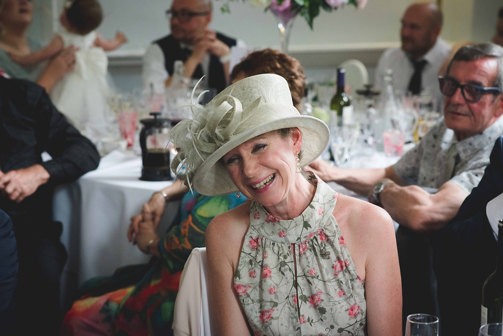 laughing guest at Somerford Hall wedding
