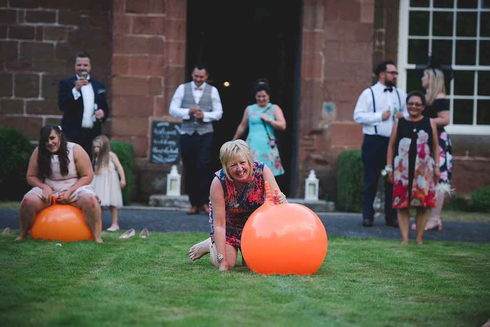 Wedding guest falling off during space hopper race at Hartlebury Castle