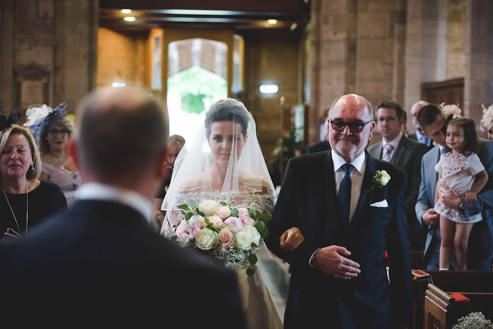 Bride walking down the aisle for Staffordshire church wedding