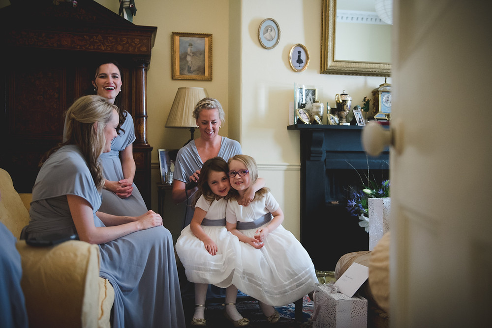 Bridesmaids and flower girls waiting for the bride before her Worcestershire wedding
