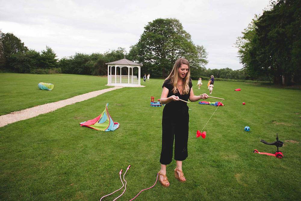 female guest enjoying garden games at Stafford wedding