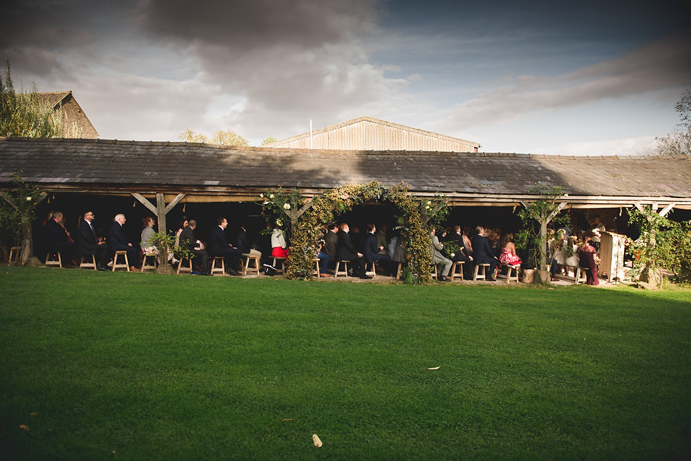 Lyde Court long barn open air wedding ceremony