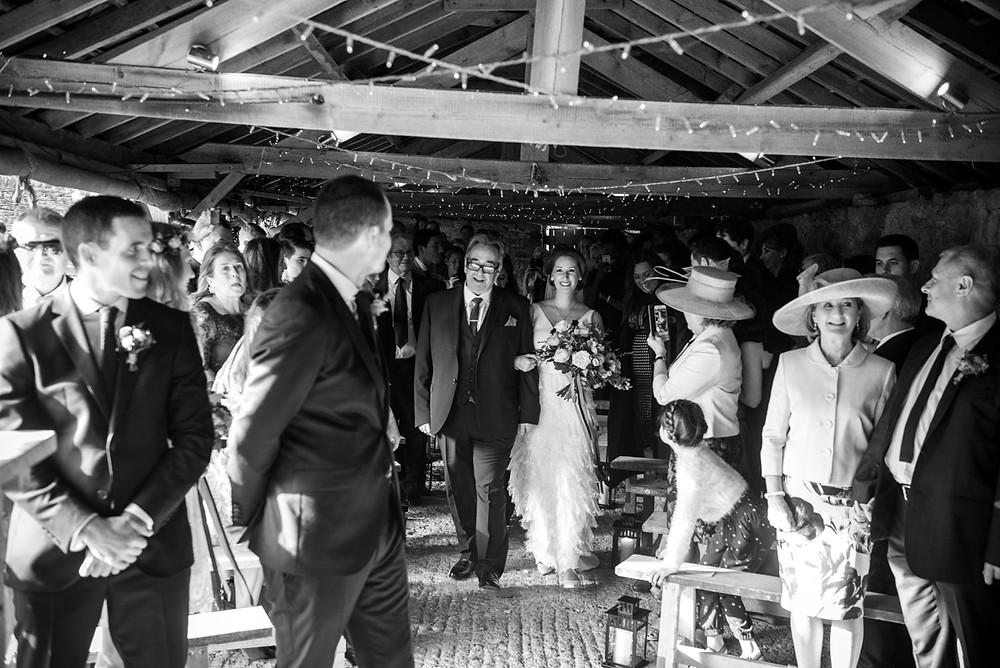 Black and white photograph of bride arriving for Lyde court autumn wedding