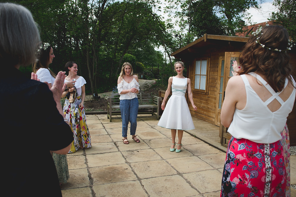 Bridesmaids seeing Bride for the first time in her bespoke wedding dress