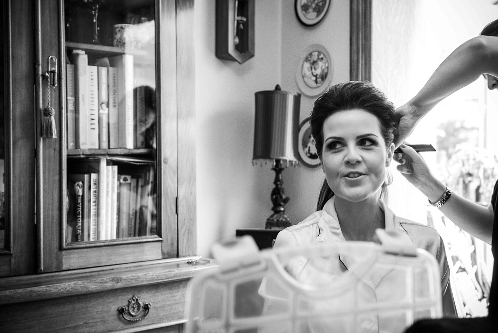 Bride getting ready before her Somerford Hall wedding