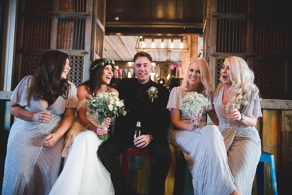 laughing bride and bridesmaids with the groom at The Loft in Birmingham