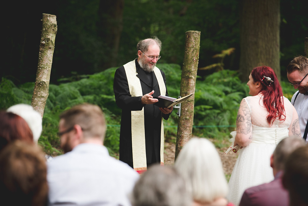 Vicar conducting woodland blessing
