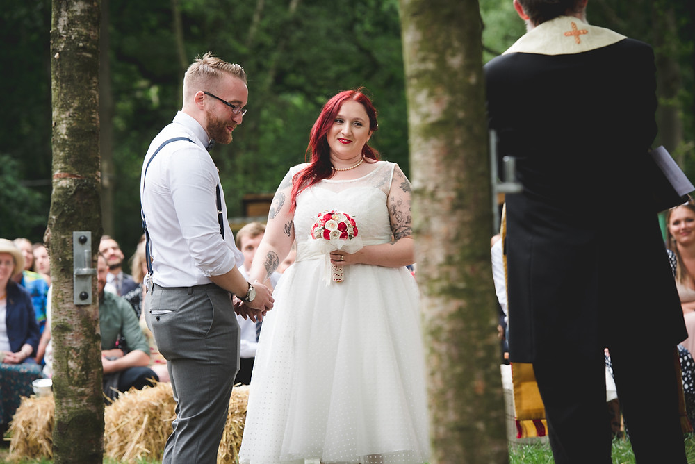 Emotional bride in Brighton Belle dress in outdoor ceremony