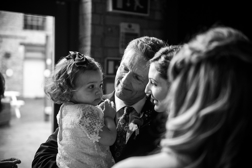 black & white documentary wedding photograph of bride and her daughter