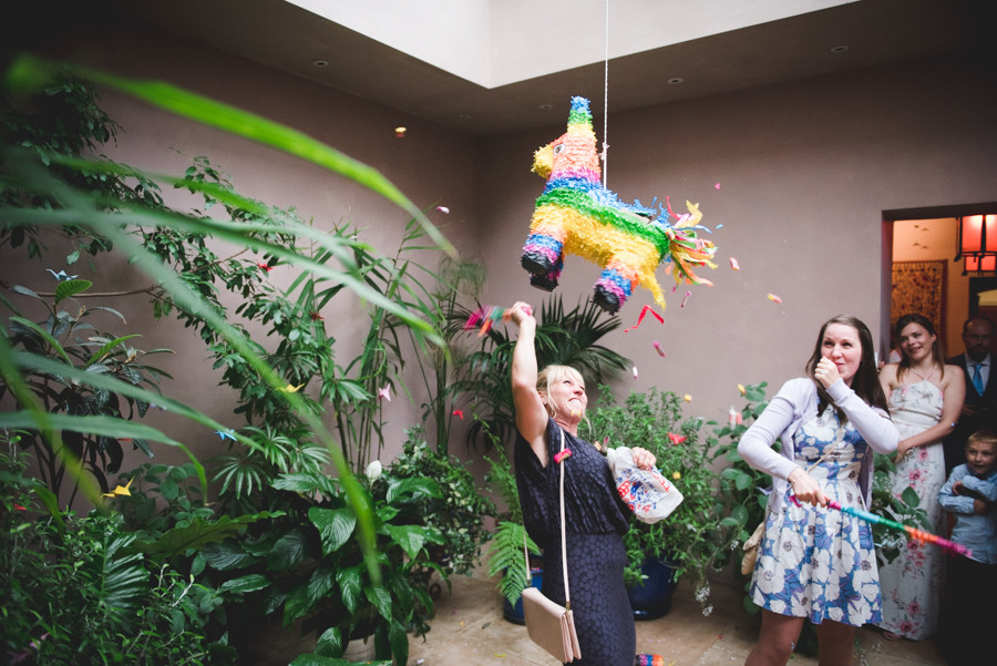 Mother of the bride smashing pinata donkey at Matara centre wedding