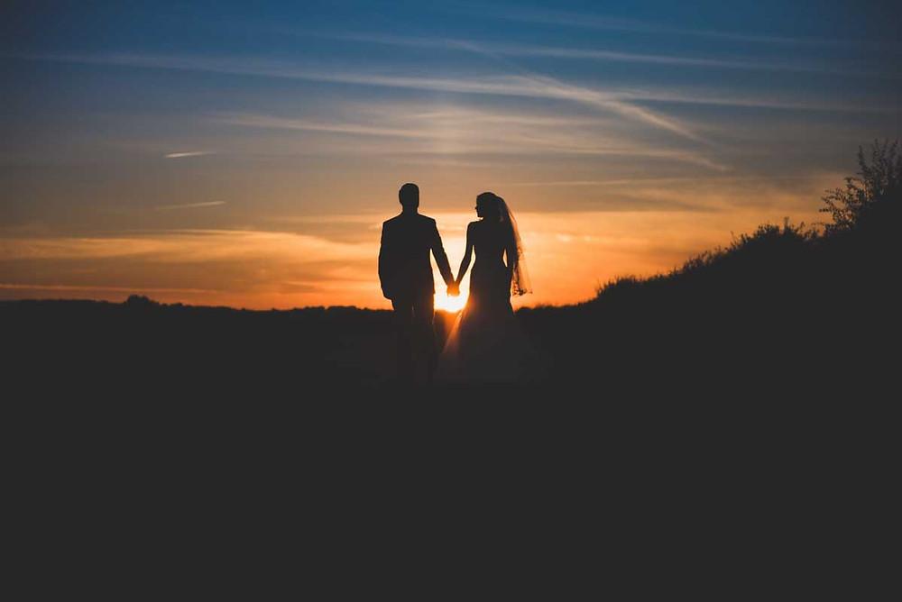 Bride & Groom walk into the sunset art Mythe Barn