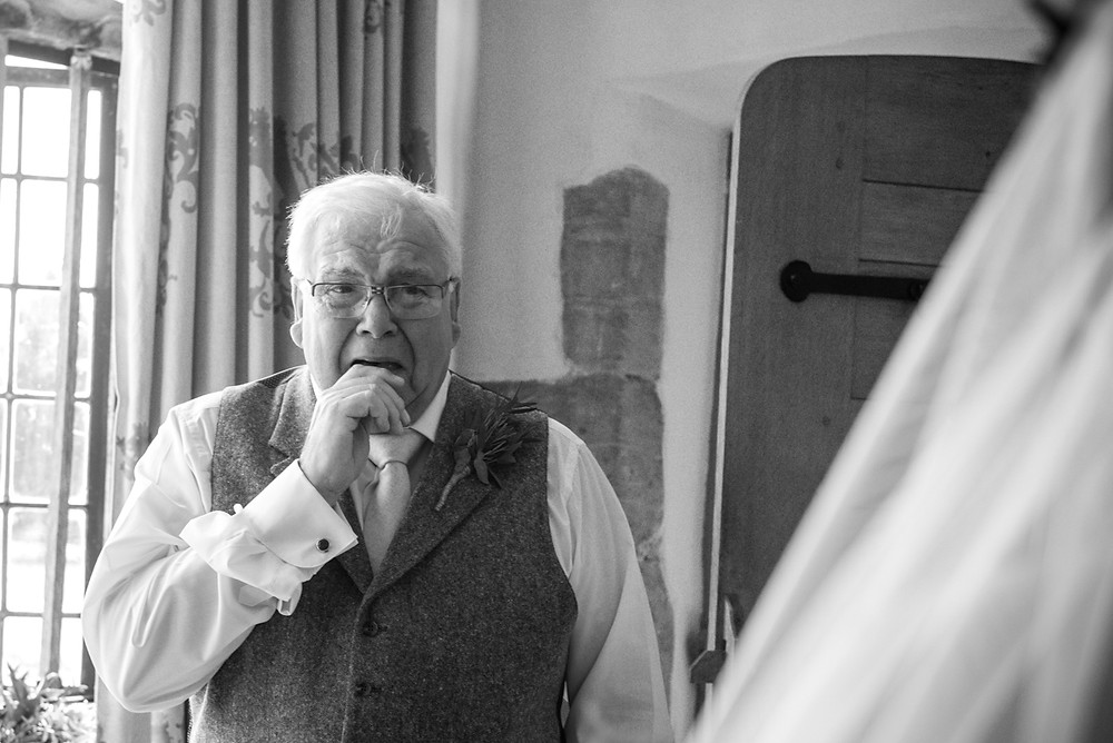 Emotional father of the bride upon seeing his daughter in her dress at Derbyshire wedding