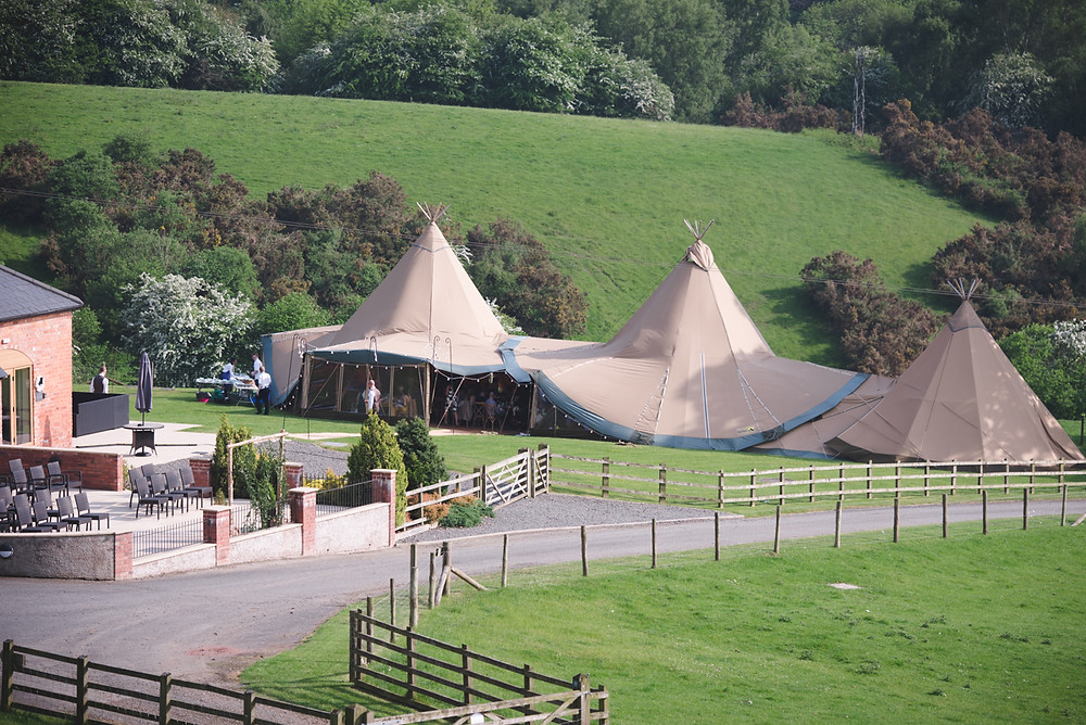 looking down the hill at wedding tipi at The Bringewood