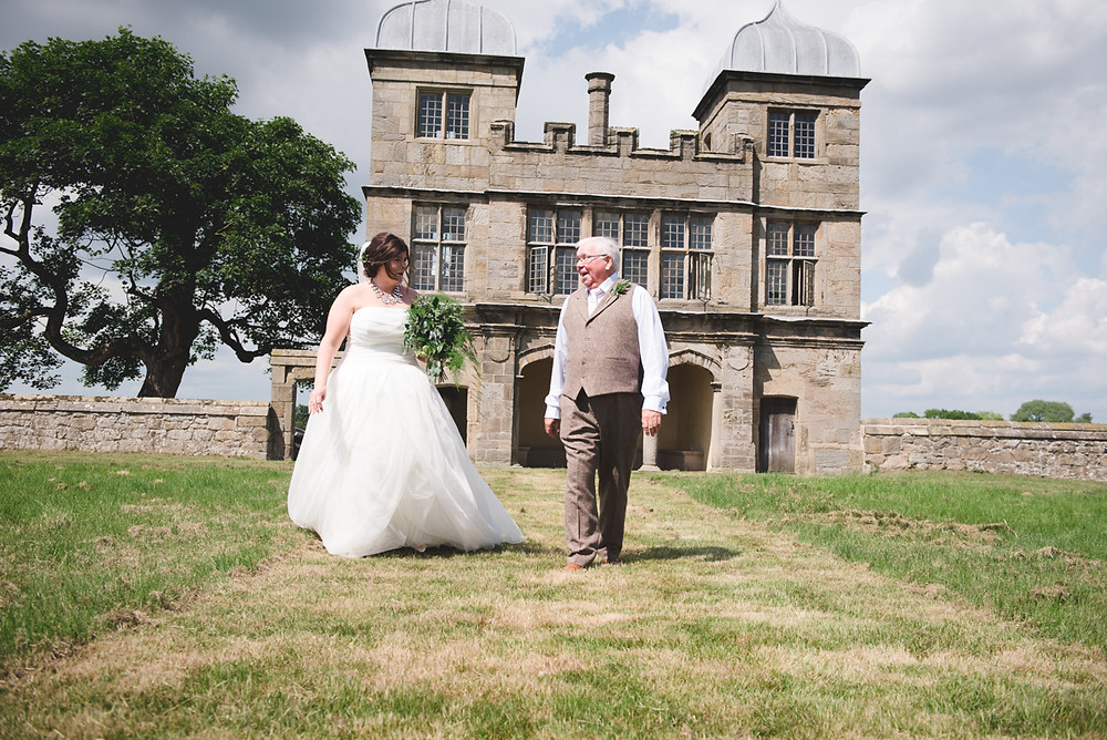 Bride and her father walking away from Swarkestone Pavilion