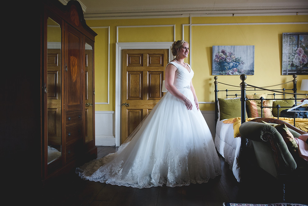 Bride in her dress after getting ready at Henley Hall