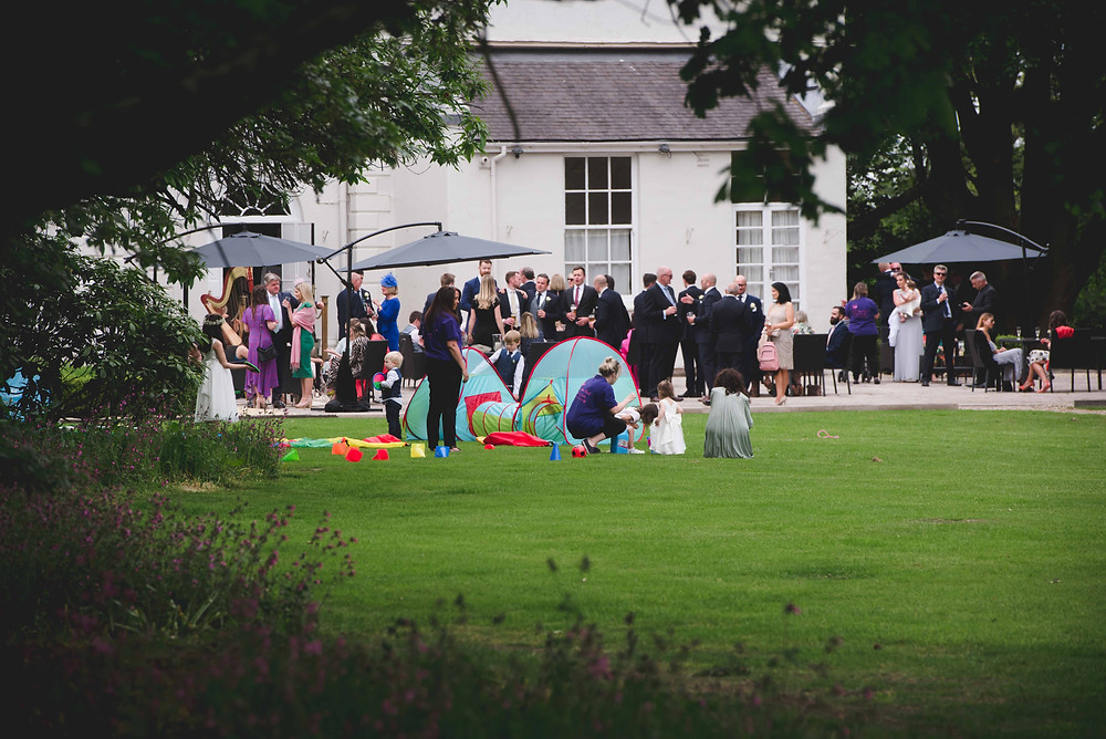 guests during drinks reception at Somerford Hall