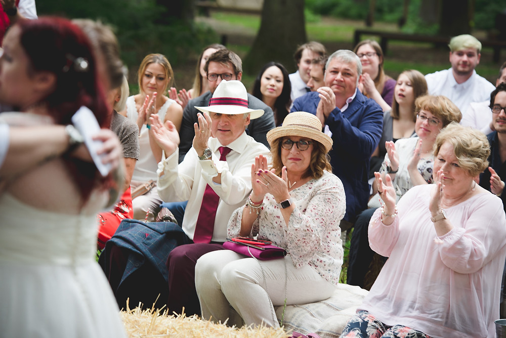 clapping guests during outdoor wedding