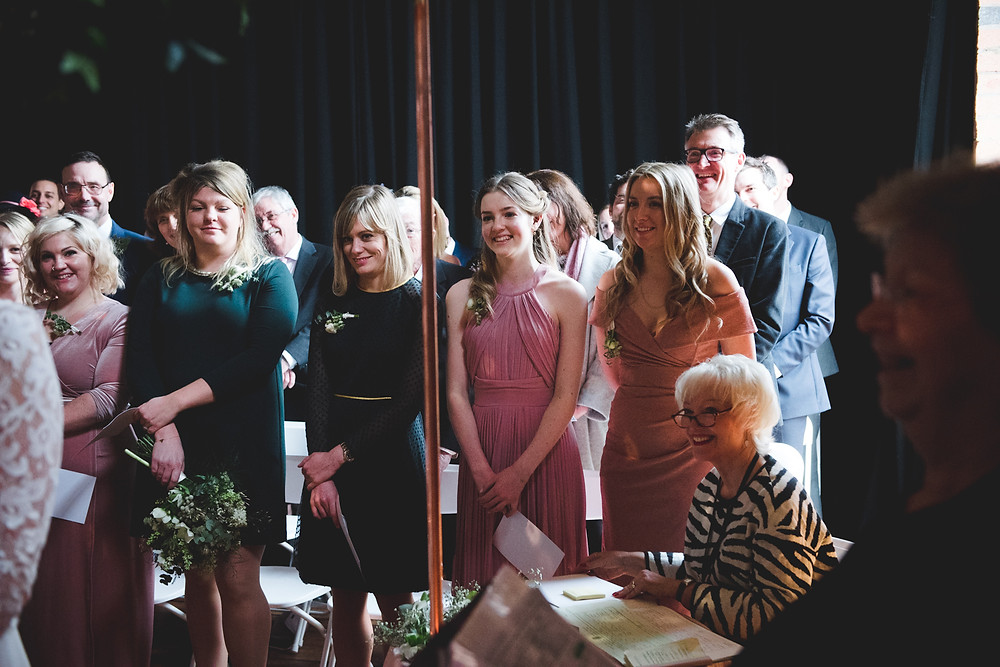 smiling bridesmaids during bristol paintworks wedding ceremony