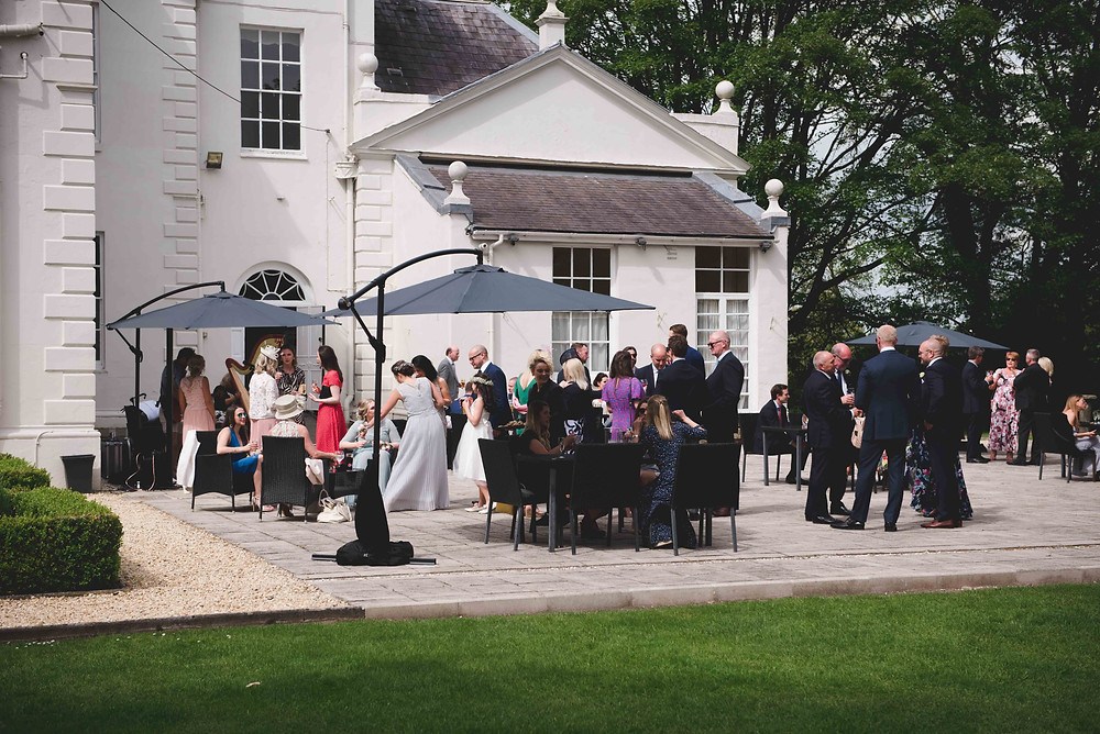 guests outside in the sunshine at Somerford Hall