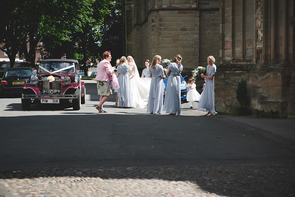 Candid wedding photography outside Worcester Cathedral