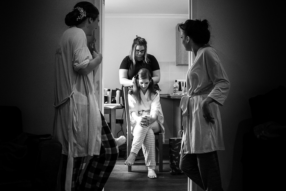 Creative wedding photo of bride getting ready at Chateaux Impney