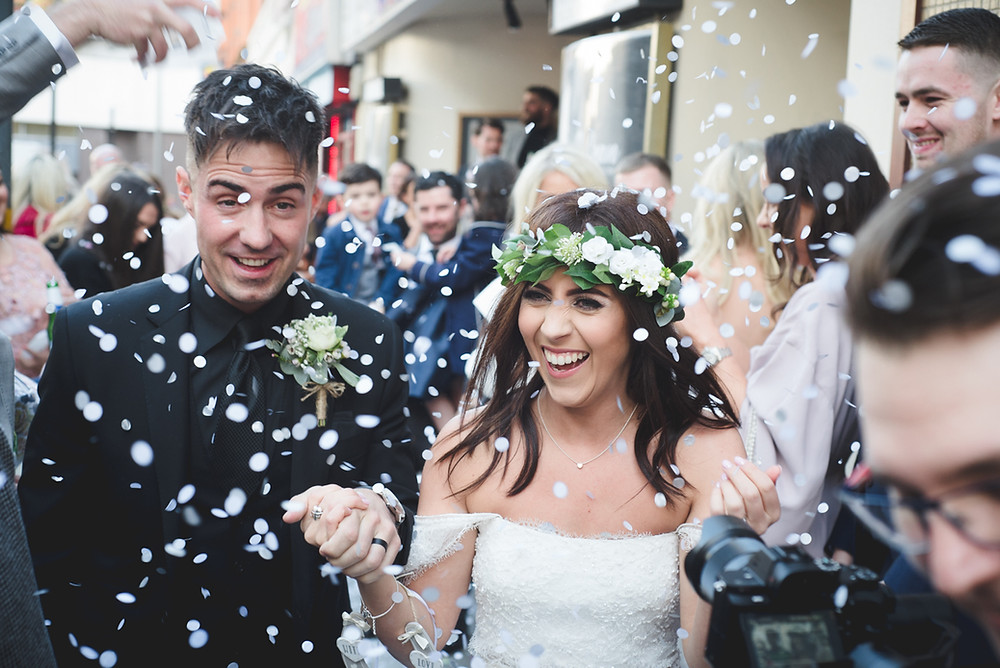 Bride & groom outside Electric Cinema in Birmingham having confetti thrown on them