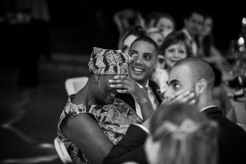 mother of groom with her head in her hands during wedding speeches