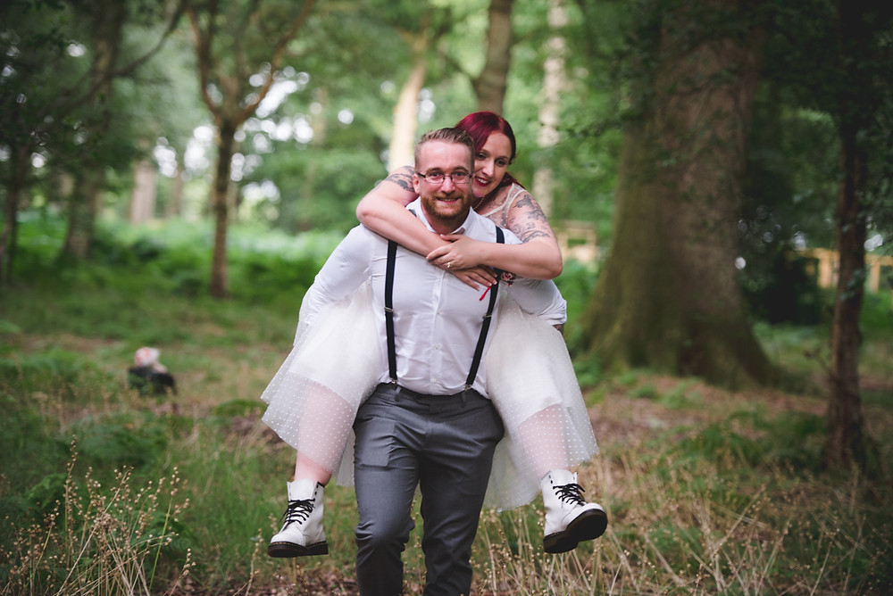 groom giving bride a piggyback at umberslade adventure
