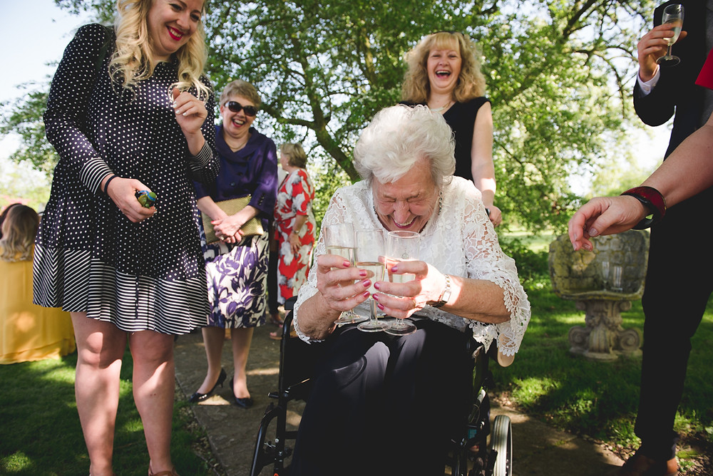 Laughing grandmother during drinks reception at Wethele Manor