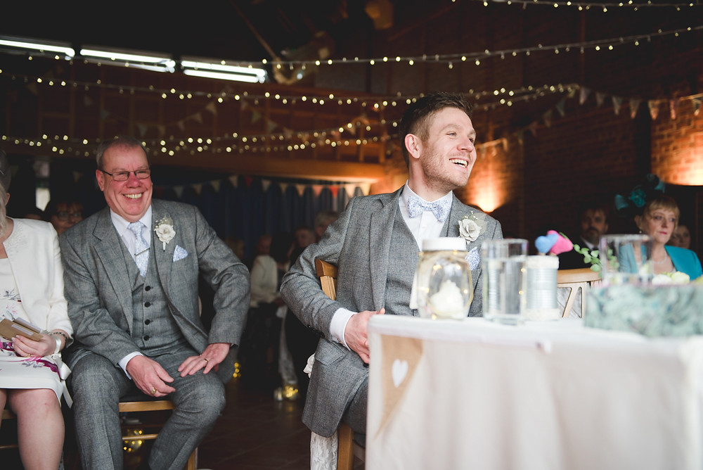 Laughing groom at Avoncroft Museum before the wedding ceremony