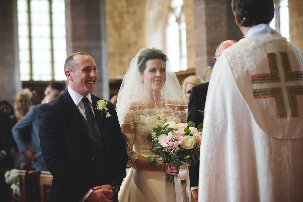 Bride and groom during their Brewood church wedding