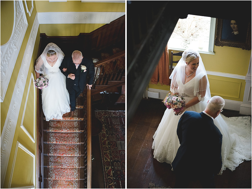 Bride walking down the stairs at Henley Hall wedding