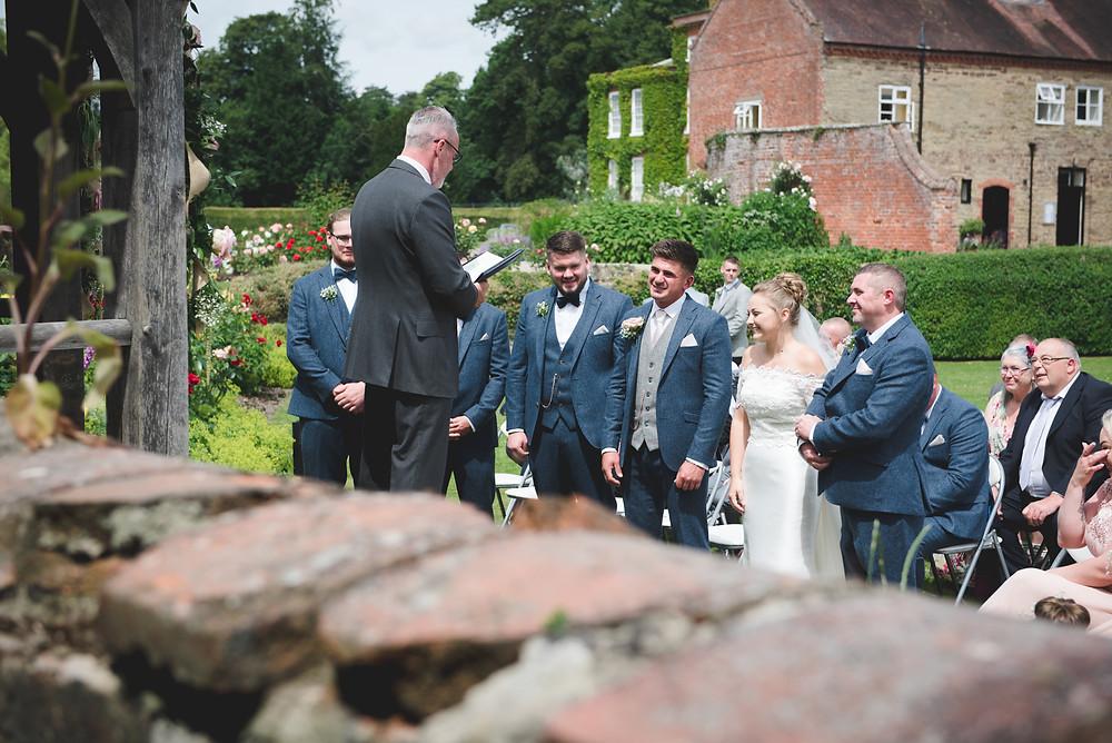 Outdoor wedding in the rose garden at Delbury Hall