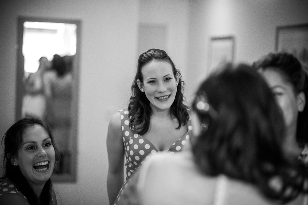 black & white documentary image of bride seeing bride for first time in her dress