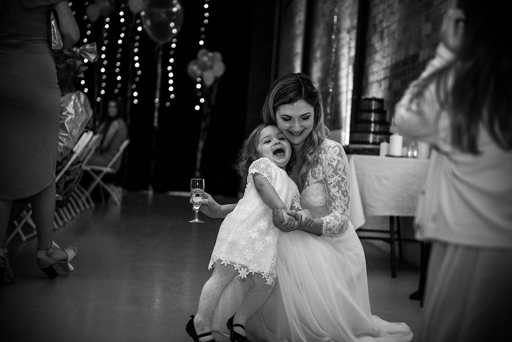 bride with her daughter at bristol paintworks wedding venue