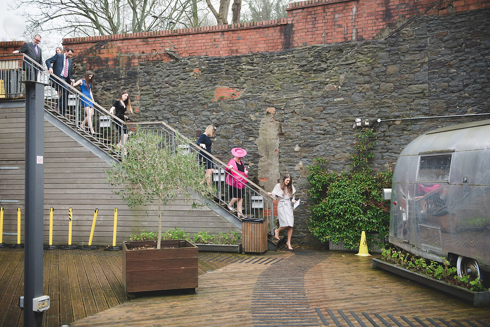 guests arriving at bristol paintworks for a wedding