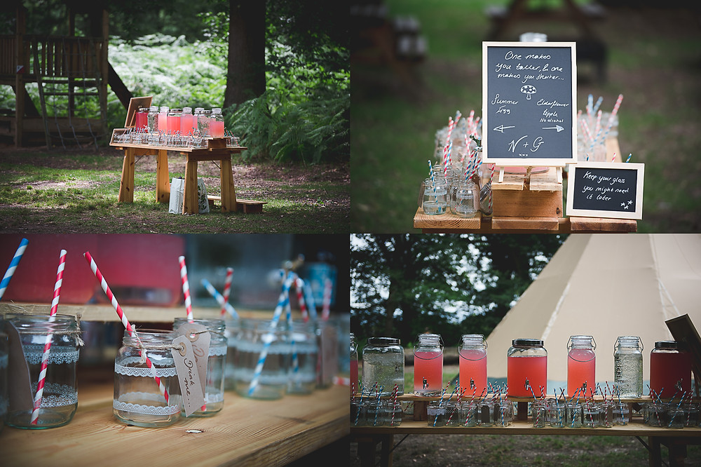 Alcoholic pink lemonade in the woods with Alice in Wonderland signs