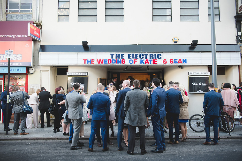 Wedding party standing outside Birmingham Electric Cinema