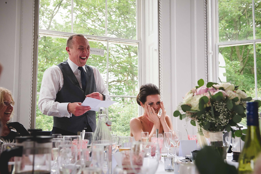 bride & Groom laughing at Somerford Hall